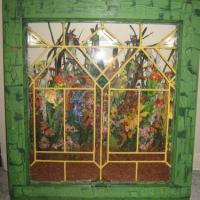 old leaded glass window, sanded and painted using crackle effect. added shelf and put wild flowers behind the glass.