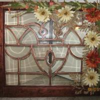 old leaded glass window from around 1900's or so. Painted with a metallic copper and a dark brown using crackle effect. Kept antique look. Added flowers.