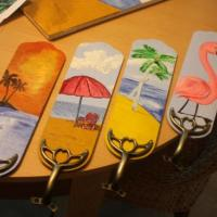 pulled off the ceiling fan blades and painted them tropical scenes.....