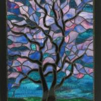 An original design using traditional stained glass techniques. This piece has thick, rolled glass in rich opaque colours. Professionally framed to hang.