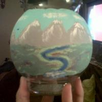 Handpainted a landscape onto glass..