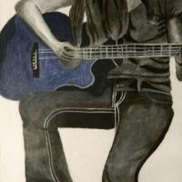 Self portrait, made with charcoal and chalk pastel used on guitar