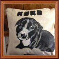 Hand painted puppy staff of a customers on a cushion in