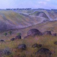 Mist hangs low in the valley on a farm near Crookwell New South Wales, Australia. The grass has grown after months of summer drought. The mossy rocks make an interesting foreground. Watercolor on 200 gsm paper.