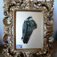 A unique slice of natural breccia rock from raw material collected and cut by the artist, then lacquered and mounted in a frame.