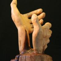 A piece from a collection of hands for holding wine bottles, glasses, etc. (A patented Collection). This piece is carved out of a 100 year old oak tree that had fallen in Turkey Pen Hollow which is just outside of Luray, Virginia.Please inquire for a pric