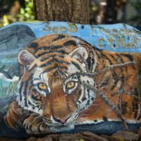 This tiger is painted on a 200 pound rock with a protective finish.