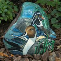 These ducks were painted on a 38 pound rock that has a protective finish.