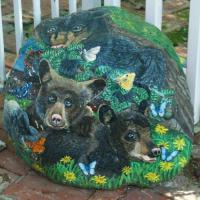 These bears are painted on a 260 pound rock and has a protective finish