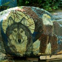 This painting is on a 500 pound boulder rock. It has a protective finish.