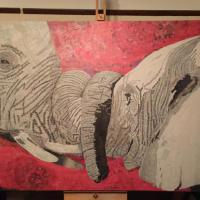 Elephants in love with a hot African backdrop made entirely from old torn up newspapers and glue